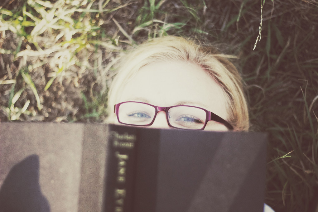 girl reading with glasses