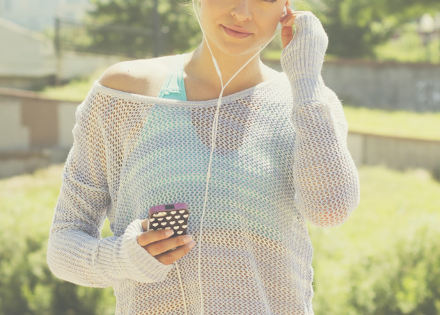girl with cell and headphones