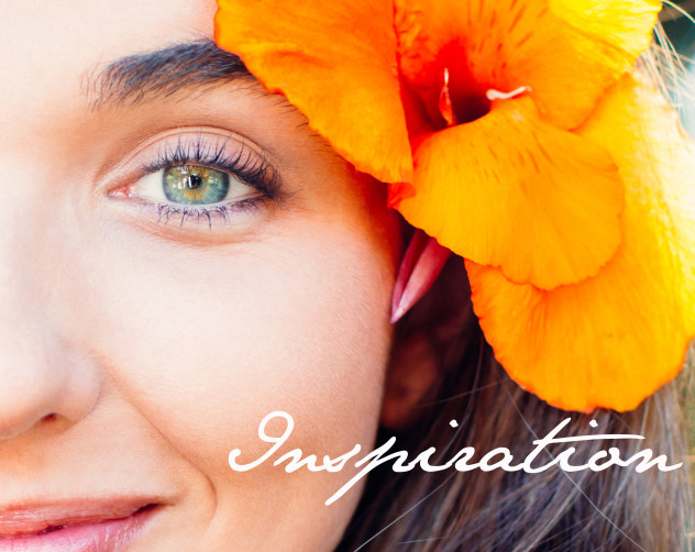 Midface of a happy and beautiful young woman with flower in hair